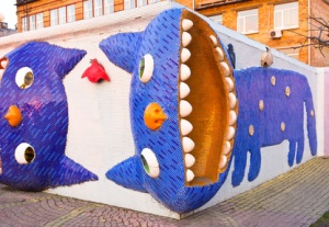 KIEV, UKRAINE - MARCH 9, 2014: The playground on Landscape Alley made by Konstantin Skretutskiy with the sculptures of meowing cats, on March 9 in Kiev.