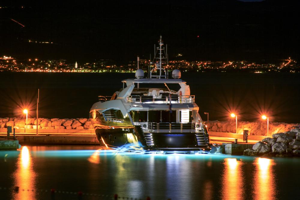 Luxury yacht moored on pier night